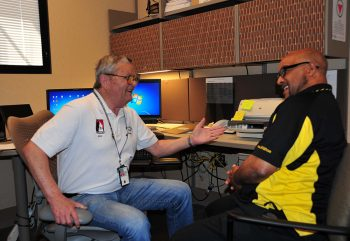 Peer Support Specialist DeWayne Raulerson shares a laugh with Army Veteran Vernon Williams at the Tucson VA. Photo by Clifford Baser