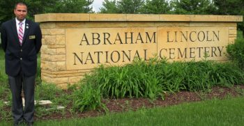 IMAGE: Christopher Hill Sr. standing next to the Abraham Lincoln National Cemetery entrance.