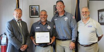 IMAGE: Jason Hogan, Cape Canaveral National Cemetery foreman, center-left, received a Patriot Award in recognition for his outstanding support of the military during a ceremony April 19, 2017. Pictured, from the left are Don Murphy, Cape Canaveral National Cemetery Director; Jeffrey Brawner, cemetery caretaker and Jack Giralco, Employer Support of the Guard and Reserve representative, April 19, 2017.