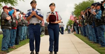 IMAGE: Cadets from the Douglas MacArthur High School JROTC receive the cremains of the five Veterans from the Patriot Guard Riders and escort them to the viewing area.
