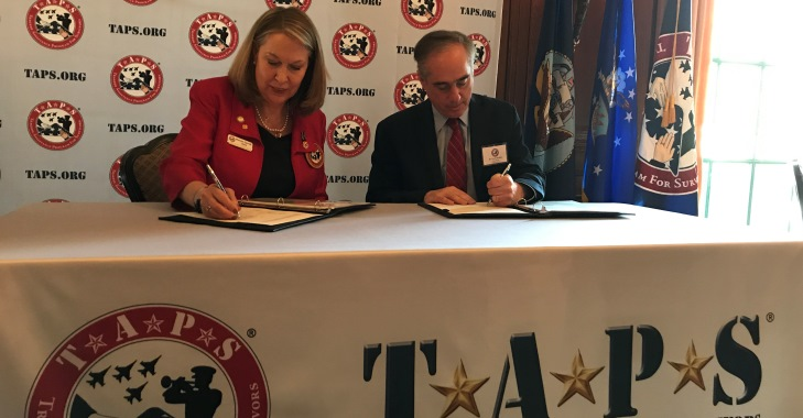 Image: Bonnie Carroll, Founder and President of TAPS, and VA Secretray David Shulkin, sign a Memorandum of Agreement April 12 at the Army and Navy Club in Washington. The MOA formalizes the organizations' long-standing information working relationship to support surviving family members as they identify and secure the benefits available to them through the military service of their loved one.