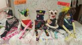 Image of handmade dolls on a table.