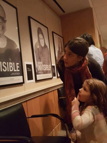 Image of a mother and daughter looking at a campaign poster.