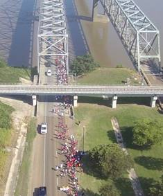 image of the parade crossing thr Mississippi River