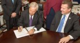 IMAGE: Curtis Coy, deputy under secretary for economic opportunity signs the apprenticeship agreement with Al Kovach, president of the Paralyzed Veterans of America.