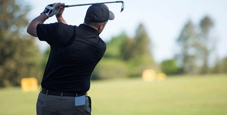 Image of a progolfer following through on a drive.