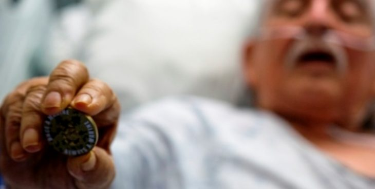 IMAGE Fidel Gomez holding a coin