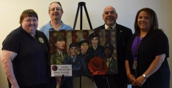Image: Veterans Cindy and Bryon Newton (far left) donated an original Heather Englehart painting to be displayed inside the new Women's Health clinic on the seventh floor of the new Veterans medical center. SLVHCS medical center director Fernando O. Rivera (right) accepted the painting, along with Health Promotion and Disease Prevention manager Gweneh Vilo (far right).