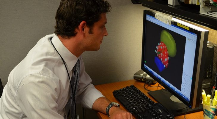 Dr. Matthew Schutzer examines a 3-dimensional diagram in preparation for the placement of radiated seeds which are placed into a patient's prostate to fight cancer cells.