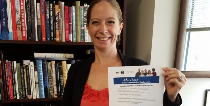 IMAGE: Kayla Williams with a signed document supporting suicde prevention efforst.