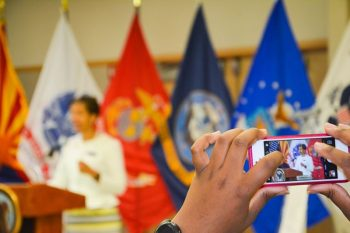 Image: A attendee takes a photo of Wanda Wright, Arizona Department of Veteran Services director, at the Be There Phoenix Resource Fair Sept. 13.