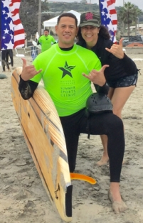 Image of Kyle and Shannon Kilchrist on the beach during the Summer Sports Clinic