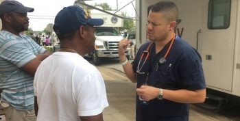 IMAGE: David Barron, VA provider talks with a Veteran