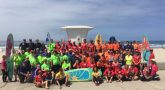 IMAGE: A group photo of the Veterans participating in the surfing event.