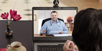 Image: A doctor consults with a patient via video.