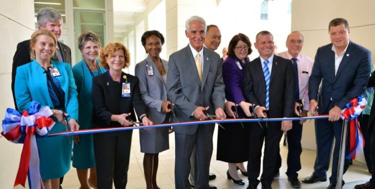 IMAGE: elected and VA officials cutting the ribbon on a new mental health facility.