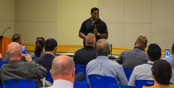 IMAGE: Football legend Herschel Walker shared his battle with dissociative identity disorder with a packed room of Veterans and VA employees, Oct. 3, at the Carl T. Hayden Medical Center.