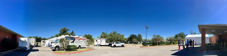 Image: mobile medical unit and a mobile Vet center serve Veterans in the parking lot