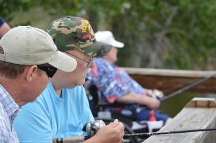 AGE: Arsenal Anglers volunteers provide hands-on assistance to visiting veterans and other eager anglers.