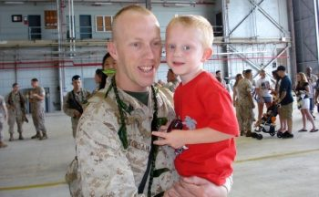 IMAGE: Joe Stordahl with his son after returning from a deployment