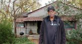 IMAGE: . VA North Texas Veteran and Dallas resident, Arthur Shelton, stands in front of his home under repair.