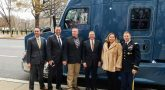 Standing outside on curb in front of new Kenworth truck