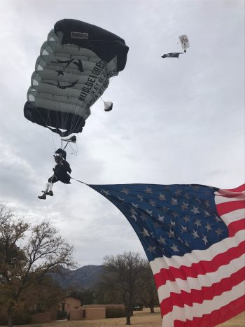 Double amputee Dan Robbins drops in with American flag to celebrate Boulder Crest Retreat's opening in Arizona.