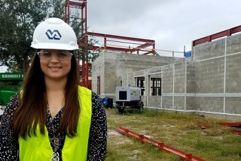 Heather Brauer, Assistant Chief of Engineering, at the site of the new Cancer Infusion Center