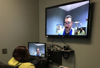 Veteran Katrina Pettus utilizing VA Video TeleHealth Technology to connect with TeleHealth Presenter, Demion Young
