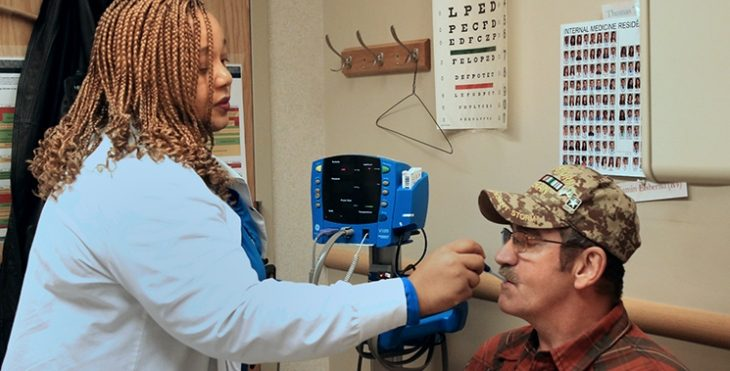 IMAGE: . VA North Texas patient, Brett Baker, gets his vitals taken by a Bravo Clinic Licensed Vocational Nurse
