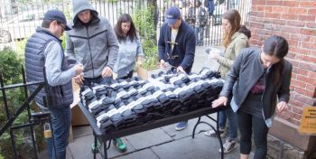 image of volunteers passing out socks