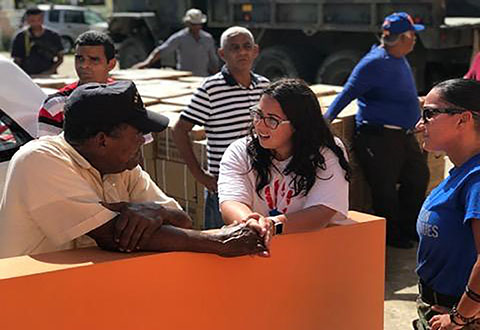 Dr. Johanna S. Rivera Anazagasty speaks with 73-year-old Marine Corps Veteran, Luis E. Rodriquez during a humanitarian mission.