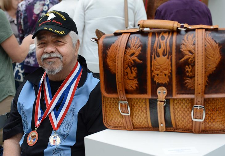 Veteran with leather artwork
