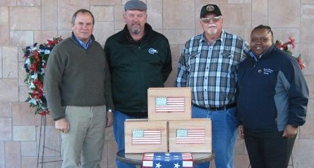 Brad Phillips, Pacific District executive director, far left, Bob Stolarski and Mike Bellsmith, of Quailwood Woodworker Club and Rachel Charles, Prescott National Cemetery assistant director display donated, handmade wooden urns.
