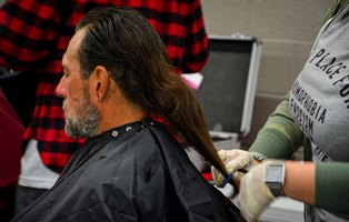IMAGE: A Veteran gets a haircut during Phoenix VA StandDown