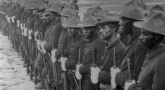 Historic black and white photograph of Buffalo Soldiers standing in formation in Cuba.