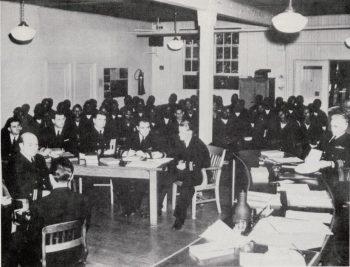 A photograph that shows the 50 sailors charged with mutiny at their court martial.