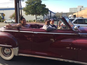 Veterans riding in convertible