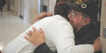 IMAGE: A VA Volunteer shares a hug with a Veteran