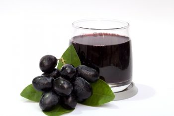 Grape and juice isolated on the white background