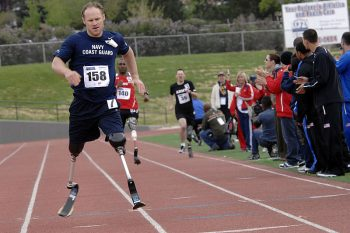 image of veteran running with prosthetic legs