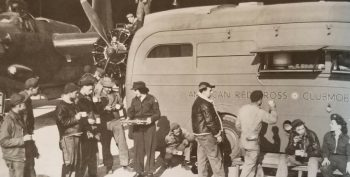 IMAGE: Troops gather around a Red Cross mobile in Europe during WW II.