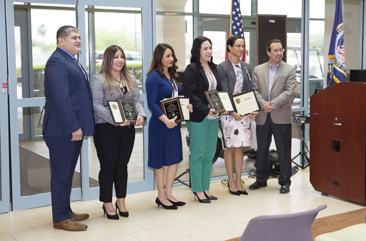 (At center) VA social workers Alondra Muñiz, Maribel Barcenas, Cynthia Gonzalez and VA psychologist Dr. Yasisca Pujols, pose for a group photo with Cameron County judge Eddie Treviño Jr. and Salvador J. Castillo, Cameron County Veterans service officer during a special awards ceremony held March 13, 2018, at the VA Health Care Center at Harlingen, Texas. The four Texas Valley Coastal Bend Health Care System employees were recognized by Cameron County officials for their outstanding work with Veterans.