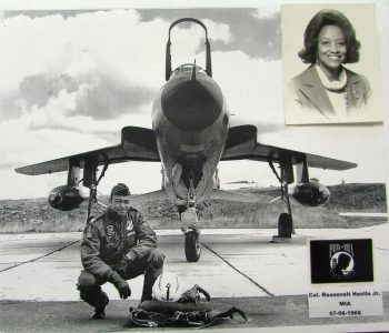 Pilot posing in front of plane