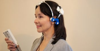 Dr. Yelena Bogdanova, Clinical Psychologist at VA Boston Healthcare System, demonstrates the LED therapy headset.