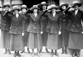 Photograph shows a group of female yeoman saluting