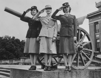 Photograph of three members of the Women's Army Corps rendering a military salute.