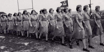 Photograph of soldiers in the Women's Army Corps marching in formation.