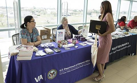(At right) Army Veteran Ms. Laura B. Vela, stops by the information booth manned by Ms. Kathleen Libke (Women Veteran Program manager) and Aleli Duque (Women Health Care coordinator), who provided information and educational material regarding Women Veteran health matters to guests at the photo exhibit, which opened to the public after VA Texas Valley Coastal Bend Health Care System's ceremony held in observance of this year's Women History Month, which took place March 2, 2018, at the VA Health Care Center at Harlingen, Texas. The Women Veterans Health information booth was one of several VA and community organizations participating in the series of events and activities held in observance of national Women's History Month. (U.S. Department of Veterans Affairs photo/Luis H. Loza Gutierrez)