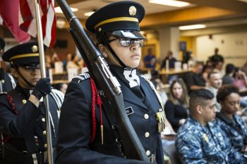 The Harlingen High School All-Female Army Junior ROTC Color Guard stands by ready to present the colors for a VA ceremony in observance of national Women's History Month, which took place March 2, 2018, at the VA Health Care Center at Harlingen, Texas. The ceremony was held in honor of Women Veterans. (U.S. Department of Veterans Affairs photo/Luis H. Loza Gutierrez)
